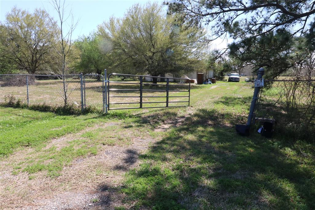 Everyone wants a little piece of heaven to build their dream home. This could be the one for you!  It's five acres fully fenced with a chain-link fence. You will find fruit trees that were lovingly planted as well as shade trees. A septic tank and water well are already there as well as electricity.  The house on the property is not counted as part of the value.  It is considered a tear-down; however, a skilled carpenter might bring it back to life.