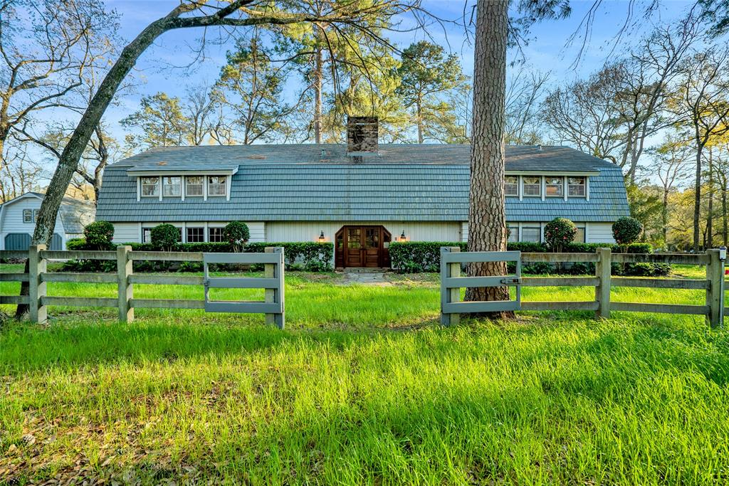 Gorgeous equestrian's paradise with tons of potential situated on 5 unrestricted acres near all of the amenities that the 1488 & I45 area has to offer! Can also serve as a perfect entertainment setting! Main residence is 4204 sqft. features split floor plan overlooking picturesque pastures. Within the main residence you'll notice tile throughout downstairs, a giant wood-burning fireplace, 2 master bedrooms, a spacious kitchen & laundry area, & a game room that can serve as a media room.  Exterior features include a 4-stall / fully equipped horse barn with an office area, an extra detached-garage which includes tall RV bay and garage apartment. Property lined with concrete fencing, 3 septic tanks, water well, and a new Generac generator that can power the entire property. The quality of this property combined with its prime location makes it a one-of-a-kind find with acreage in a high-market area! Schedule a showing today!