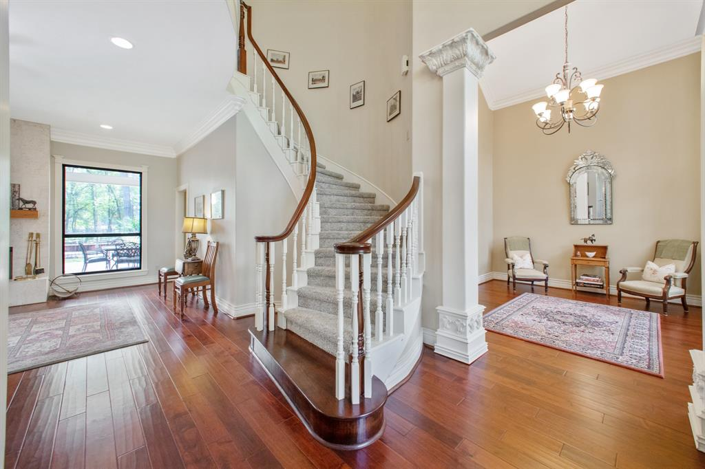 """This AMAZING, almost 3 acre Estate has been given a COMPLETE make over! Quality materials and workmanship from the gorgeous floors to the tall ceilings. A unique setting, country living but close to the conveniences in the city. Updates include walnut floors, lighting, hardware, faucets, counter tops, fireplaces, custom beech cabinets, crown moldings, custom windows. Also, 3 hvac units and a tankless water heater were recently installed. Imagine relaxing on the covered deck by the pool and hot tub. Step out of the Master suite and into this pool on hot summer evenings. No neighbors behind. Master BR down,4-5 BR up,4 full baths and a half bath, a study, """"man cave""""/media room, and extra large laundry w/built in shelving and desk.!Custom 200X66 Dressage horse arena! Don't miss the great High Meadow Ranch Golf Club! ALSO Available, an additional 2 acres,on a different tax statement, adjoining this property,which has barns and stable&water well, all fenced, horse ready."""