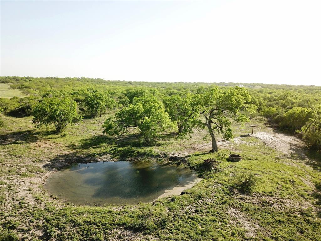 Located 2.5 miles off I-37 near the small town of Oakville, TX, this 413 acres is loaded with a diverse mix of high protein South Texas brush & huge live oak trees. Over a mile of Salt Branch Creek traverses the ranch offering 70 ft of elevation changes and interesting terrain for deer, turkey, hogs, quail, & dove. This property has 3 water wells, all of which pump water into the 3 stock ponds. One of the wells is equipped with an electric submersible pump, and the other 2 have solar pumps. The wildlife on the ranch is plentiful including whitetail, turkey, and hogs.  The area is known for its healthy quail population and outstanding dove hunting.  There are 3 food plots on the ranch, which can be planted to bring in the doves. The ranch is perimeter fenced with 5 strand barbed wire, and is in good condition.