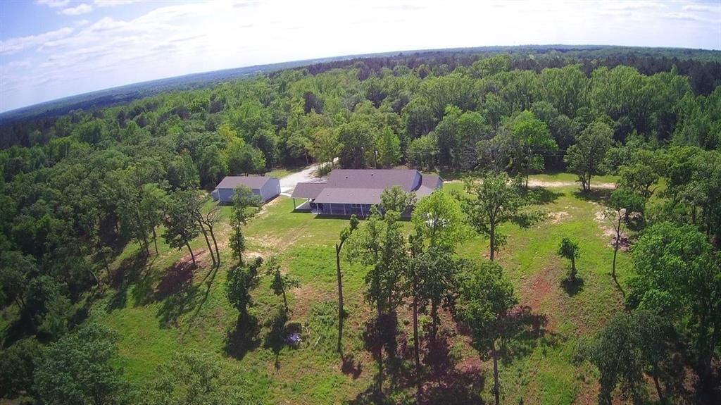 This 371 + acre property has it all from breathtaking views, gorgeous lodge built in 2019, 5 acre lake and some of the nicest elevation changes in Leon County. The 5 bedroom 3 & 1/2 bath home sits on a high hill overlooking the lake and beautiful woods. It has an oversized attached carport and large detached garage/shop with a very nice guest suite. The ranch is mostly all hard wood timber with some pine and has roads and paths throughout for easy access with 4 wheelers and equipment. The fence rows are clean with newer fencing all around the ranch. The property is located just outside the city of Centerville and has good access on the I-45 west feeder road and CR 317. Wildlife is plentiful with deer and small game everywhere. It is located approximately half way between Houston and Dallas.