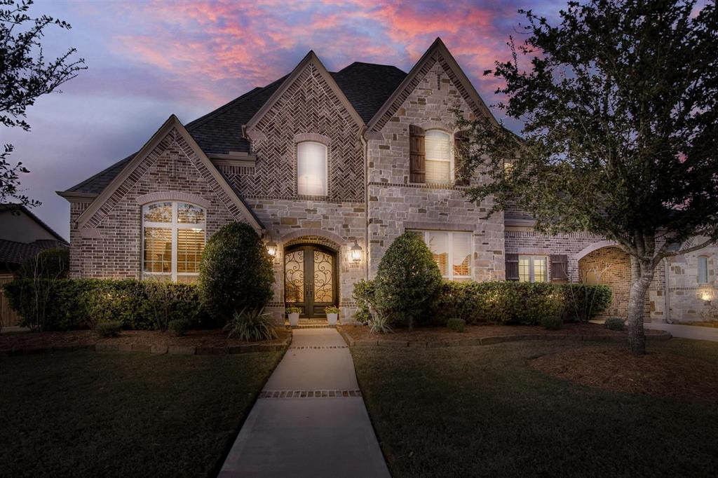 GORGEOUS estate Huntington Home in Legacy at Cross Creek Ranch. Traditional 5579 sq ft., 5 bedrooms(2 down) with 5 full baths and 2 half baths. Porte cochere with separate storage room. Grand entrance, hand-scraped floors on both levels. Stone fireplace in Family Room(floor to ceiling) with custom beams. Gourmet island kitchen with farm sink, 6 burner stove top, double ovens, bar with ice-maker, tall lit custom cabinets and desk area. Breakfast area with window seating. Large master suite secluded with sitting or exercise area. Three bedrooms up, huge game room, study or craft room, bar with wine cooler, media, double desk with built-ins and balcony. Custom plantation shutters throughout. Step outside to your own PARADISE.  International Award Winning Pool & Lazy River, large outdoor covered kitchen and another separate covered patio. Zoned to Katy ISD with Elementary, Junior High and High School(opening in the falloff 2020) all located in the neighborhood.  A MUST SEE!!!!