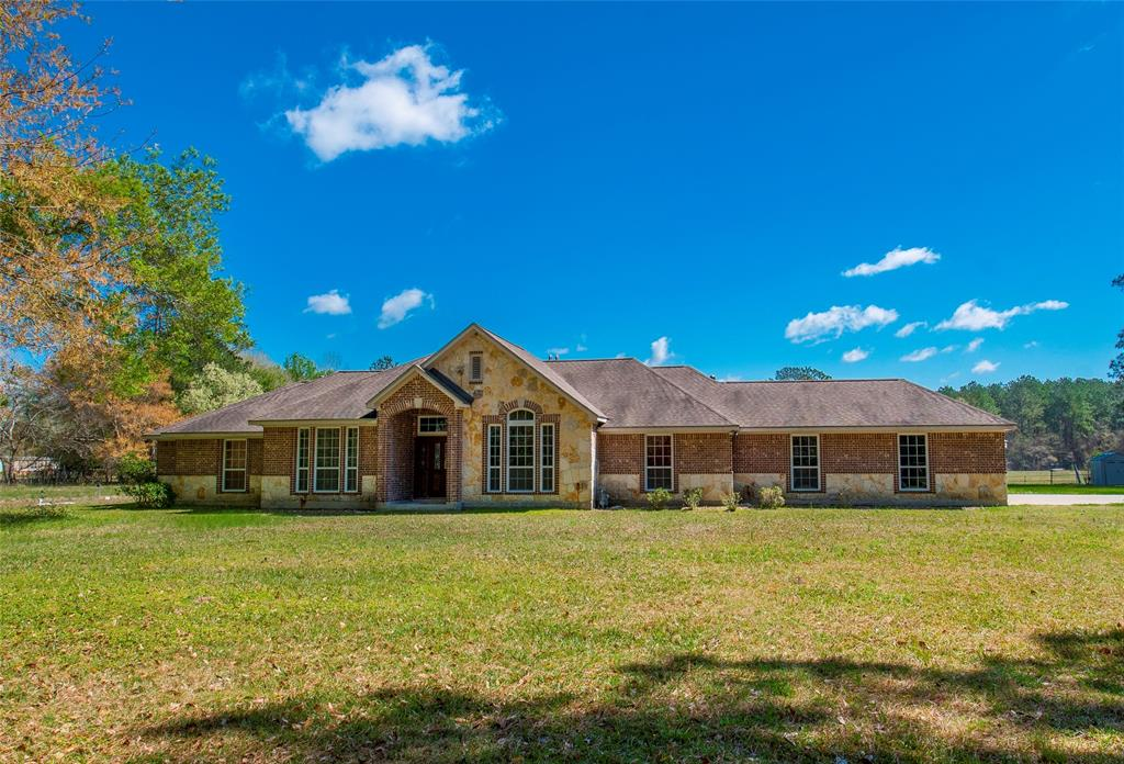 This beautiful 4 bedroom home in Tarkington ISD is the epitome of modern country living! The 10 acre tract offers seclusion and privacy while still being just minutes from town and HWY 59/HWY 105 access. The custom built home features an open concept living space, with a split plan. The architecture of arches and reinforced corners, maple cabinetry, 10 foot ceilings, and smart home features in the kitchen, family room, and master bedroom all add to the already stunning concept this home has.The salt water pool in the back yard is the perfect outdoor space! With a large pool, spa/hot tub, and 2 outdoor showers with hot water make this the best entertaining space. The covered back patio features an outdoor dining area as well as flood lights, mood lighting, and a fire pit. You do not want to miss out on this luxurious home in the country. Visit the photo gallery to see the intricate stone work and attention to detail this home offers.