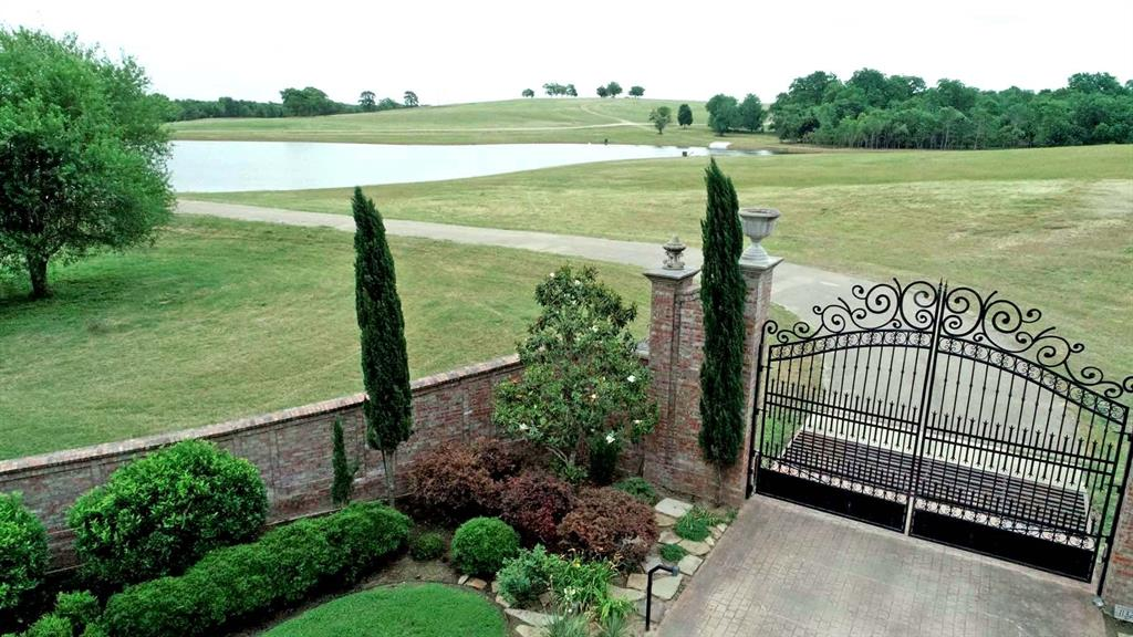 Leading into the ranch, you will pass through a beautifully landscaped brick and wrought iron entrance. The electric entrance is equipped with it's own well and irrigation system making the landscaping easy to care for. Just through the elegant gate is the newly rebuilt and stocked approximate 6 acre lake. Feed and fish for large mouth bass from either the bank or take advantage of the boat ramp and reel them in from the middle. The asphalt driveway leads across the dam offering a scenic drive into the ranch highlighting one of the many high points of elevation being offered. The winding drive continues on past numerous large pecan trees and beautiful rolling hills. With 80 foot of elevation change and multiple potential building locations, choosing the perfect home site may take awhile. Comfort will be easy to find in the adorable, newly expanded 1bed/2bath cabin that sits near the middle of the ranch. This ranch boasts some of the most breathtaking long distance views in this region.