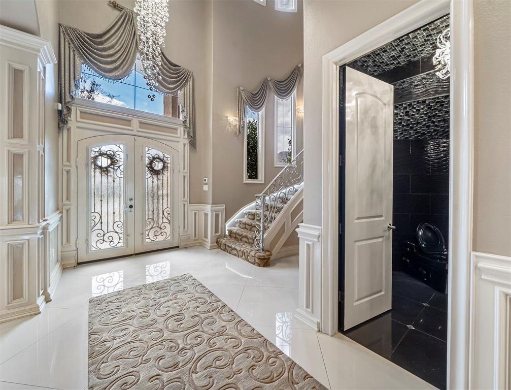 Looking for a Luxurious, custom built home? Look no more! This incredible custom home has 6500+ sq. ft living space w/luxurious finishes and tons of upgrades. Upgrades include expansion of the living room, addtnl natural lighting & porcelain floors. Gorgeous custom stucco & stone exterior w/well-manicured landscaping. Enter through the double steel doors into an entry that flows seamlessly into an open floor plan with formals. Chef's gourmet kitchen equip w/exotic granite countertops, custom cabinetry, chandler, wine refrigerator, & high-end SS apps. Oversized living room w/stone fireplace, large master suite w/sitting area, double entry shower, & custom walk-in closet. Upstairs include 3 bdrms & 1 oversized bdrm, large walk-in closet, game room w/balcony. Other features include 4 car-garage with guest retreat (1bd/1bath/kitchen/living), cold storage room & so much more. Oasis in the backyard w/ beautiful pool & outdoor kitchen. You must see it for yourself! Stop by today!