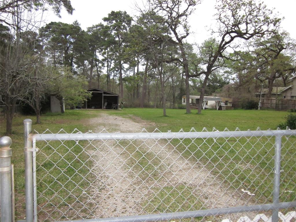 Great piece of property! Would make a great office area! Can be a rental with a workshop, or two rentals. Unrestricted land with 1.3 acres of total fenced in up front of property. The rest of property is behind back fence line. Can handle 2 horses, dogs or cats. Can be used as a boat storage or RV etc. There is a single wide mobile home on property with 2 bedroom and 2 full baths.  There is a carport that can handle 2 vehicles with a workshop off the back. Also has living quarters with a full kitchen, 1 bedroom and full bath.  Water is free due to well.
