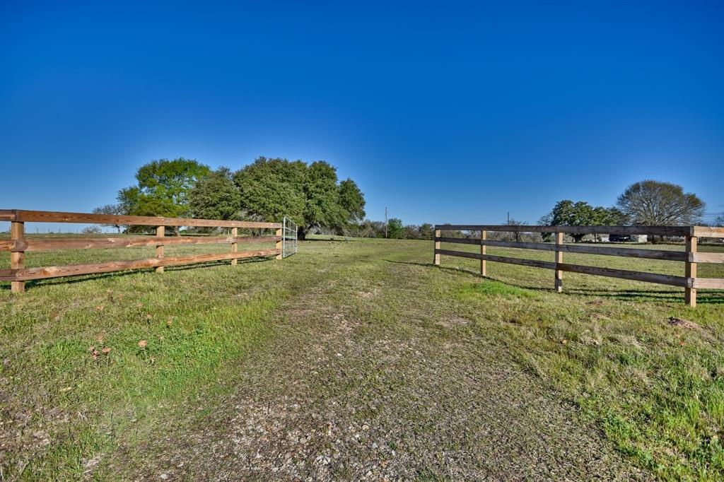 This 21.18 acres is the perfect country setting, conveniently located midway between Houston and Austin. A beautiful home site sits at the top of this property at 340 feet, where you can see for miles. Mature oak trees scattered throughout, completely fenced, and a pond allows you to run cattle and maintain the ag exemption. The back of the property slopes off towards Nails Creek, which provides a great environment for an abundance of wildlife. There are light restrictions to protect your investment. Electricity on site, water well needs a new pump.