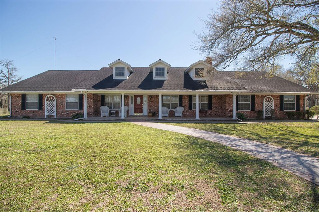 12.25+ acres of Central TX landscape at its finest. 3/2.5, 4,047 SF colonial front home, from the minute you enter the property you will see COUNTRY AND ELEGANCE! Updated home eludes quality w/built-in's throughout, crown moldings, wainscotting, beamed ceilings, custom kitchen cabinets (soft close), granite countertops, recessed lighting, beautiful chandeliers, breakfast bar, wet bar, formal dining area, and so much more. Master bath w/jetted tub, walk-in shower, his/her closets. Sunroom stretches across the back of the home with view of the huge pond (stocked) with pier for fishing. Property is fully fenced and the yard surrounding the house is fully fenced with wrought iron fencing. Property has a barn with pens & storage shed. Cattle guards at the driveway entrance off Hwy 90A and at the driveway for the home's garage. Also, available for purchase is a nice 1189 SF house on 1.837 acres next to the subject property.