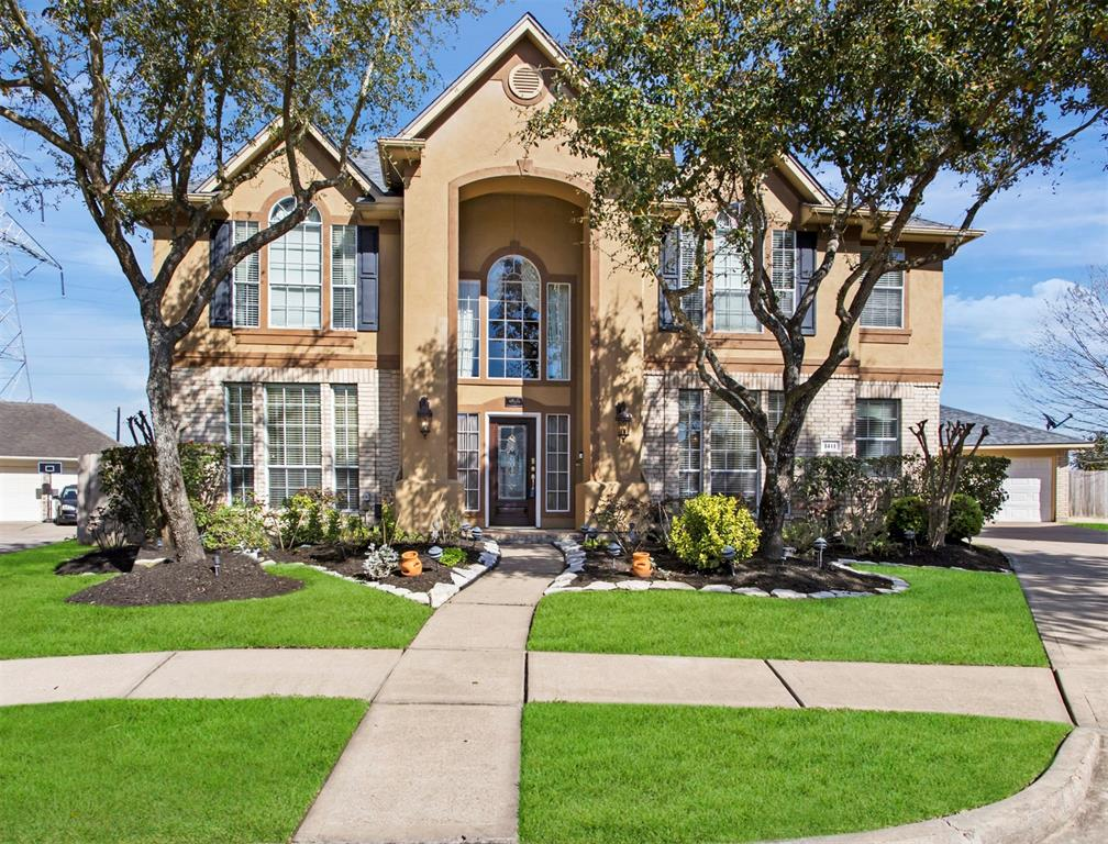 STUNNING home on oversized 13,000+ sq ft cul de sac lot w/ NO BACK NEIGHBORS in well established New Territory! As you enter this METICULOUSLY cared for home w/ spacious room sizes, you will notice all of the upgrades such as arched doorways, travertine flooring, chandeliers, & upgraded custom paint   The Chefs kitchen is sure to amaze with its abundance of cabinet space, large island & upgraded stainless steel appliances awaiting your culinary inspirations.  The master suite is sure to please with a wall of windows, tray ceilings, & ensuite bathroom with dual vanities, soaking tub, & large closets. Upstairs GAME ROOM with extra room, perfect for home Office! Step outside to your covered patio which overlooks a HUGE backyard w/ mature landscaping & the privacy that comes with no back neighbors.  Plenty of room for a pool!  LOW TAX RATE of 2.49   New Territory features resort style amenities, top ranked schools and a convenient location near Grand Parkway 99, 59 and 90...DON't MISS IT!