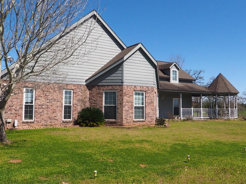 Come see this neat and clean brick home on almost 22 acres with just the right amount of trees and a nice sized pond. The home is bright and inviting with large double-paned windows, open living area with vaulted ceiling and sliding doors to the back deck. The kitchen features custom Encore oak cabinets, a gas cooktop, double ovens, and tile back splash. The master suite has a large walk-in closet, tiled walk-in shower and double vanities. Includes a 20'x30' workshop with a concrete floor and electricity. Easy living in the country that's just 5 minutes from Fayetteville, 20 minutes from Round Top, and 90 minutes from Houston.