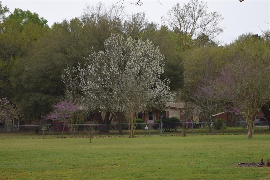 Charming home setting on 6.67 acres.  The property would be great for horses, 4-H or FFA projects. Property also has a 2 bay horse stall and 2 large ponds. This property has many possibilities. It has an additional water well with electricity. Covered outdoor deck with an above ground pool.
