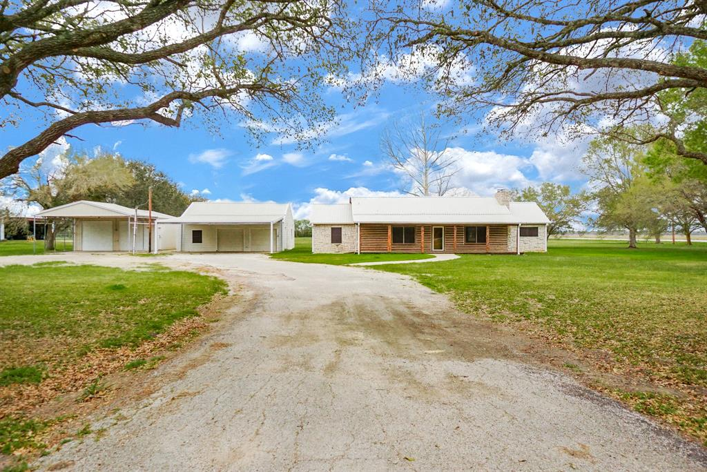 Beautifully updated 3 bedroom two bath home on 2.6 acres in Needville ISD! This property also offers a guest house and a garage workshop. Horses and FFA 4H projects are allowed and there is plenty of room to build a nice barn. This property is located in private airpark community offers grass and paved landing strip and there is plenty of room to add on to existing garage for small plane parking. This one is priced to sell schedule your appointment today!