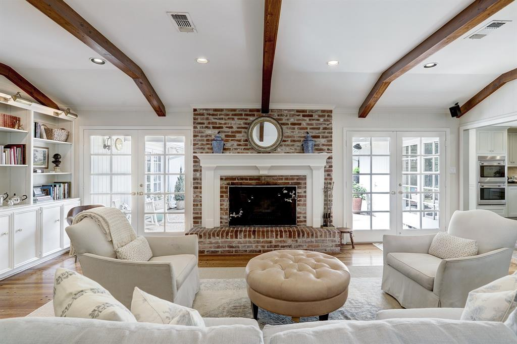 Beautiful antique heart pine beams embrace the living area. This is a generous space that is light and bright.