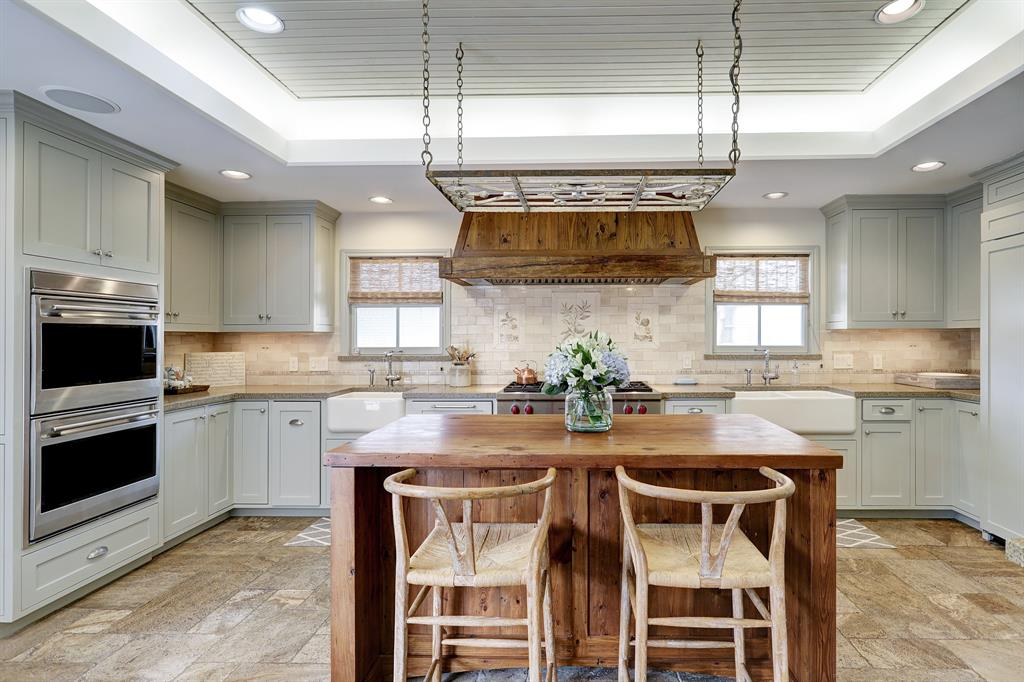 Living area flows into this great entertaining kitchen. Antique heart pine wood hood and island are one of a kind.