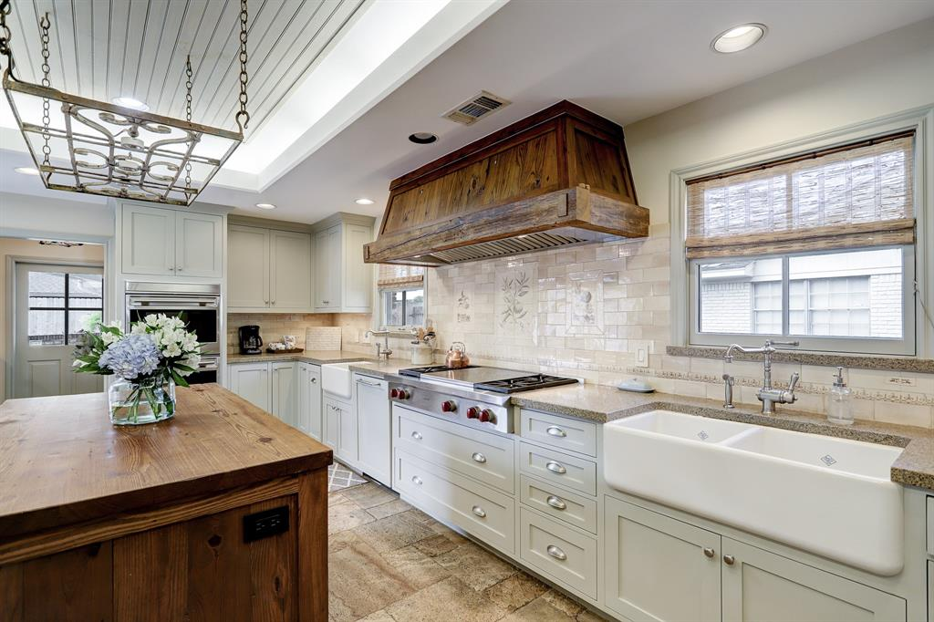 Lots of wonderful features! Two Shaws farmhouse sinks originating from England line the side wall, honed granite countertops with under counter lighting, Wolf four burner gas range with Wolf vent hood and Wolf double ovens.