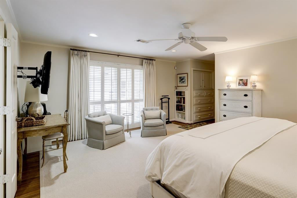 Beautiful windows with plantation shutters open up to the backyard and pool area. Additional storage in built in cabinets when you walk in the room.