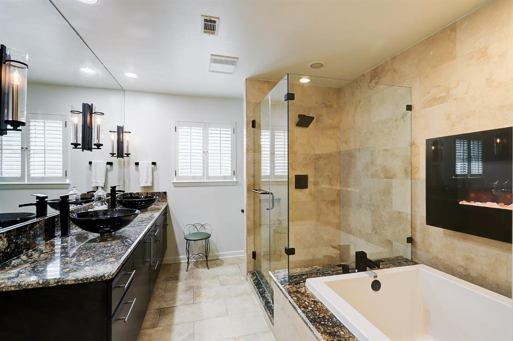 Double sinks, walk in shower, and large bathtub in the master bedroom.