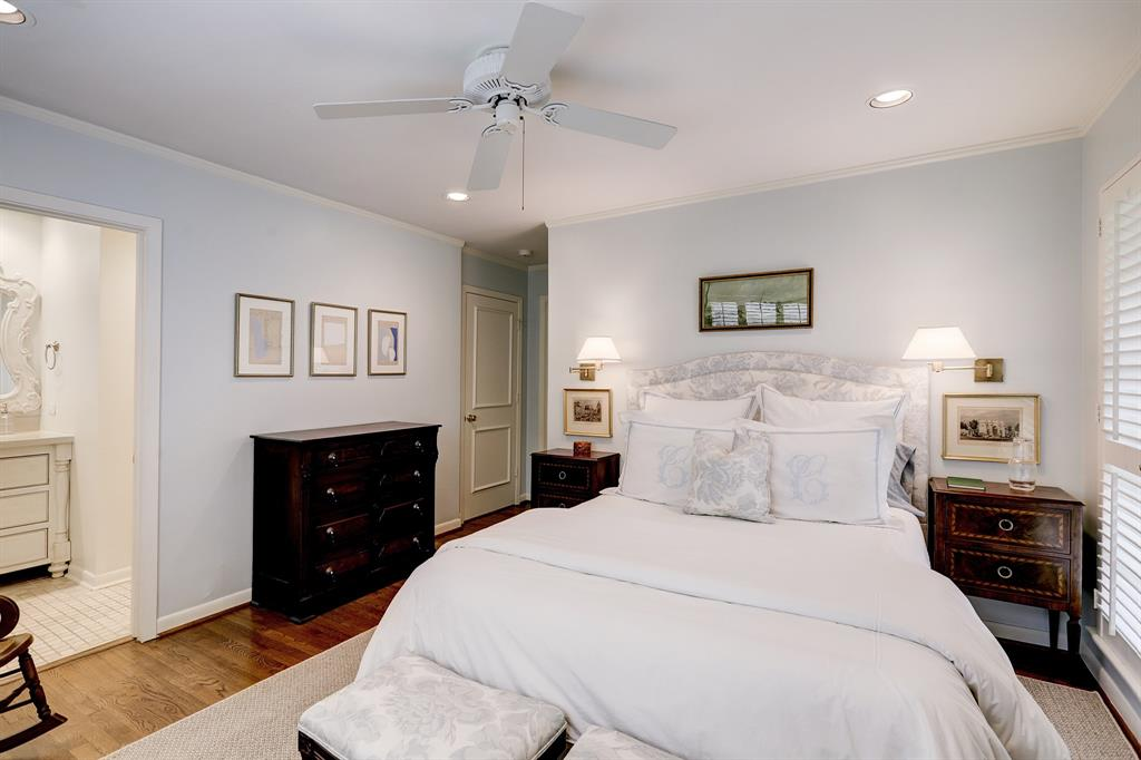 Front bedroom is fresh and airy. Features a connected full bath, large cedar walk in closet and additional storage closet.