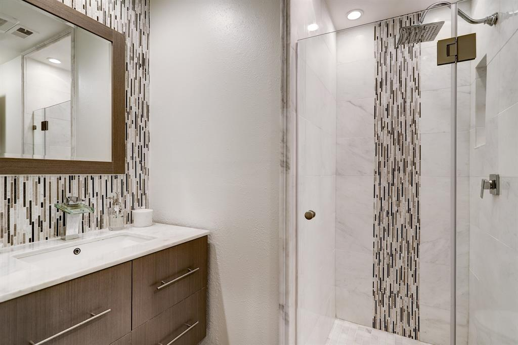 The third full bathroom is located off the hallway. Features a walk in shower.