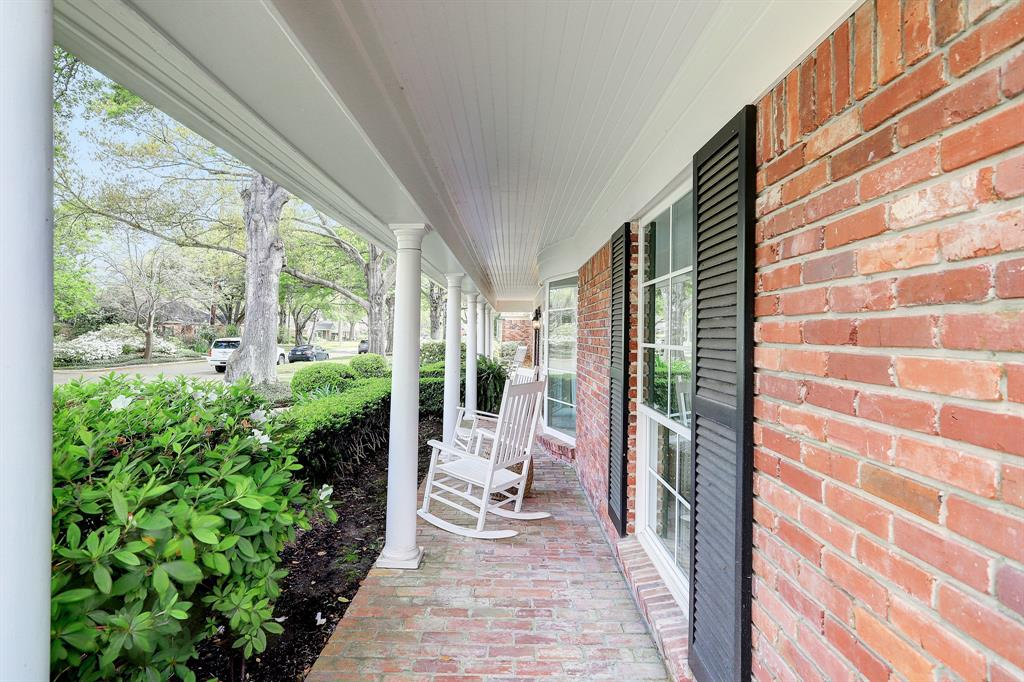 Classic front porches stretches along the front of the home. Perfect place to relax in a rocking chair.