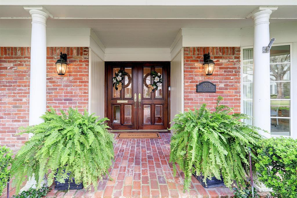 Welcoming double doors lead you into the home.