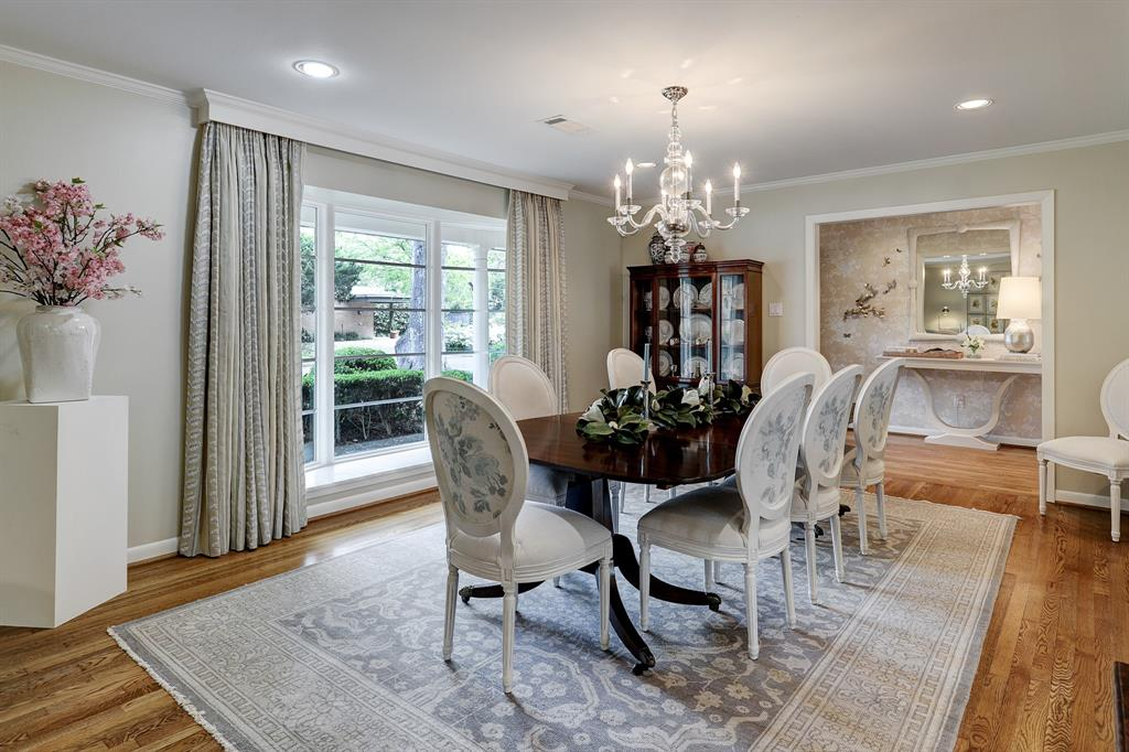 Formal dining room is to the right when you walk in. It is perfect for entertaining and has enough room for a large dining table and china cabinet.