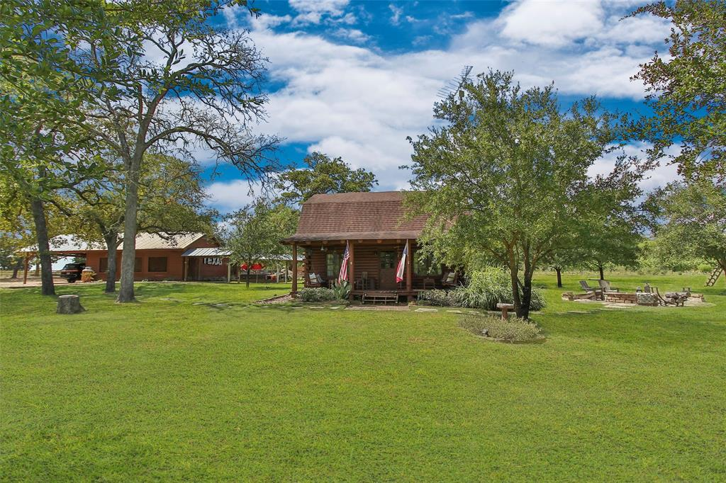 Mini Ranch Retreat just 70 miles West of Houston and 5 minutes to the Historic town of Brenham. 15 minutes to Round Top! Perfect for Weekend Getaways, feeling of complete seclusion in the Country! Main House has two Master Bedrooms w/En suite baths, Wood Burning FP down & Electric FP up, open floorpan and unsurpassed Cozy Feel w/Modern Designer touches. SLEEPS 12+ Stone FirePit, In-ground Pool, Grilling Deck, Separate 1080sf Entertainment Room w Pool Table, WetBar, Refrigerator and Stone Fireplace. Custom Treehouse Playground w/ Climbing Rock Wall, 15ft tall & 6ft wide Slide.  Huge Post Oaks and Live Oaks throughout property.  ATV shed.  Add'l Garden shed. Visits from neighboring Longhorns are a joy at the fence line. Entire property fenced.