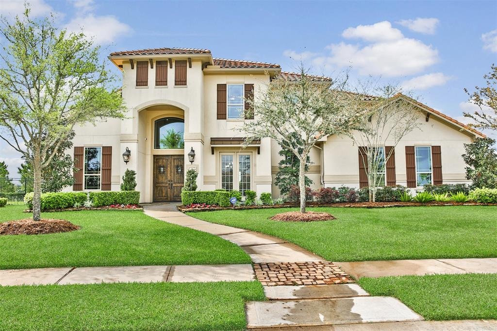 Welcome to 58 May Water Ln located in the beautiful gated community of Lakes Of Cross Creek Ranch. This Mediterranean style home features tile roof, 4 car garage, 5 bedrooms with 2 down, 4 full and 1 half baths, game & media rooms. Expert landscaped yards, solid wood DBL front doors adds privacy and elegance to this home.  1st floor has wood floors throughout, wall of windows overlooking Negative Edge pool/spa w/amazing lake views plus inviting Pergola w/Pizza Oven + sitting area.!  Island kitchen w/ 2 conv. ovens, 2 wine captains, built-in SS Refrigerator, LRG walk-in pantry, tons of cabinets & under counter lightning.  Family Room is highlighted by Stone Fireplace & Bay windows. M Bedroom has wood floors, Ensuite bath w/dual vanities + makeup area. 2nd BR down has own bath/walk-in closet. Upstairs has 3 additional bedrooms all w/walk-in closets.  Hidden storage room in game room. Lake view from every angle of back yard paradise! Outdoor kitchen with DBL grills, granite, 2 bars!!