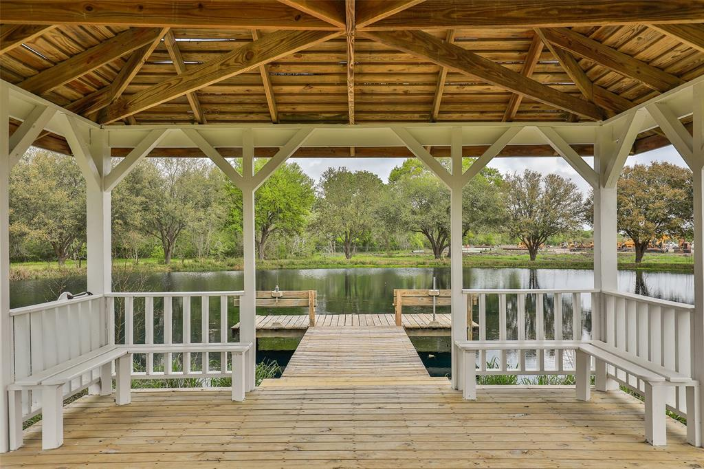 Charming Country Estate built as original owner's family home\approx. 14.77 acres zoned Residential or Commercial. Choice location on FM 2218 only approx .3 miles South of Hwy 59\I 69.  Lox Tax Rate. Pool with Safety Fence, Large Barn area w\Third Garage can be used as Party Barn\Entertaining, or as Quarters since it has a Bath w\Shower.  Also included is large Storage Area (approx. 50 ft X 60 ft)with 2 garage  openings for easy access & perfect to park & store work vehicles and equip. Walkway from a Gazebo leads to picturesque Fishing Lake & Fishing Dock by Gazebo. Three bedroom home features a Flex Room off of Master. Use as a Study,Play Room or Second Living Area. Freshly painted with New Carpet, Updated Kitchen w\Granite Counters, New Appliances & Fixtures. Front Safety Gate.Water Softener. Excellent Possibilities for Commercial use as well. Extra Driveway space for parking & navigating equipment\vehicles. A Must See to enjoy the full experience of this Ideal Country Retreat.