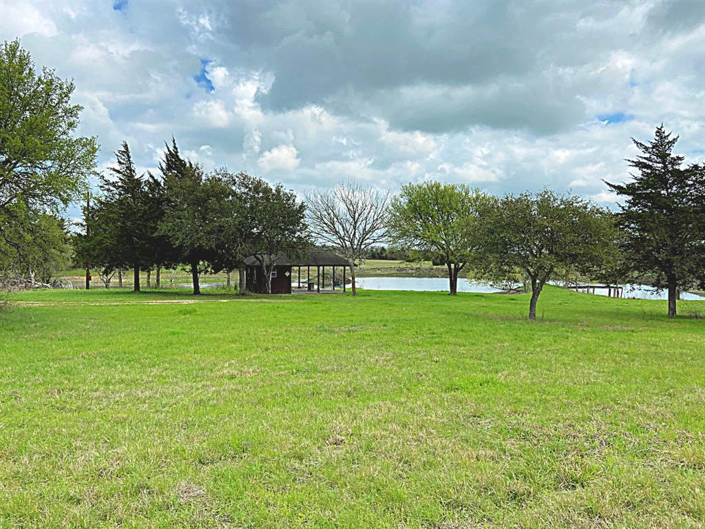 """47.797 ac on HWY 237 only a few minutes from Round Top. This rolling tract has scattered live oaks and a private driveway offering great seclusion, has two large lakes stocked with bass and catfish AND a lovely hillside homesite with VIEWS. Enjoy this country getaway in a prime location about halfway between Round Top and Burton two of the most sought after historic villages in Texas. Antique and cultural festivals in Round Top, the Historic Texas Cotton Gin Museum and festival in Burton along with many country restaurants and taverns with live music and great dining.  Furnished with a picnic pavilion and storage shop, perimeter fenced, pier and electric service on site. Has a current wildlife exemption. Good grass cover and abundant wildflowers. """"DEED RESTRICTED"""" NO COMMERCIAL USE, PROPERTY TO BE USED FOR SINGLE FAMILY RESIDENTIAL, AGRICULTURAL OR WILDLIFE USE ONLY"""" NO MANUFACTURED/MOBILE HOMES OR TRAILER CAMPERS. Seller to keep all minerals and waive surface rights per future leases."""