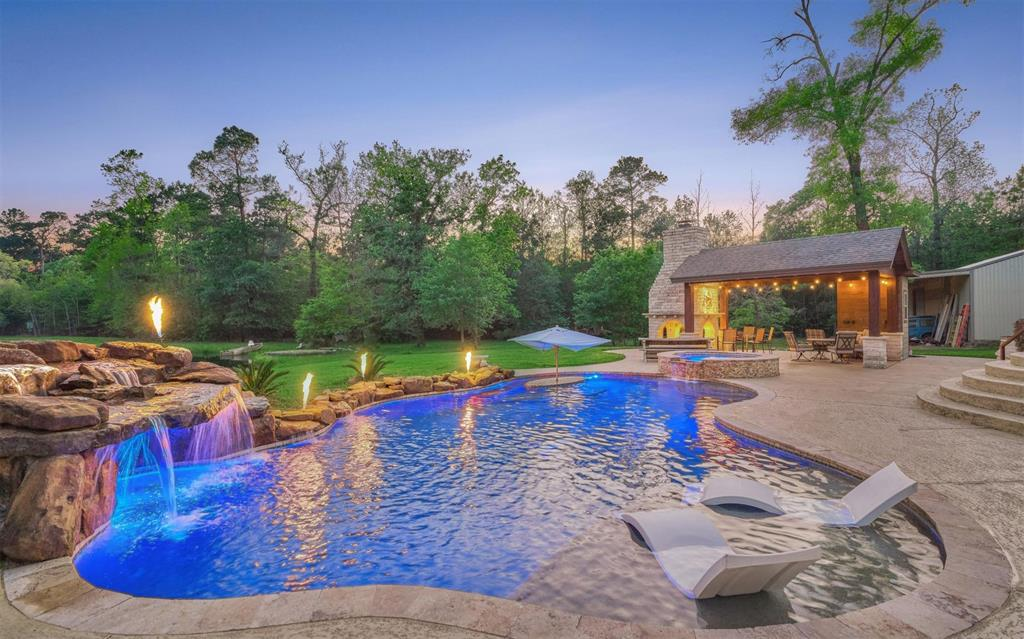 Absolutely breathtaking 10 acre property in Magnolia! Very secluded end of the road privacy. Private owners retreat with 2 granite topped vanities, corner tub, separate shower and spacious walk-in closet. Spacious kitchen with granite countertops, SS appliances, gas cooktop and a breakfast bar. A big gameroom and a guest bedroom with loft are also downstairs. Upstairs you will find an additional gameroom, spacious bedroom and a full bathroom. Behind the home is heavily wooded and has abundant wildlife and features a sparkling pool with rock waterfall and spa, serene stocked pond with fountain and a pavilion with stone fireplace and 1/2 bathroom. Handyman's dream 30x50 garage/workshop with 2 part epoxy floor, 3 10x12 rollup doors, 1/2 bathroom, running water, 220 volt 50 amp welding outlet, 220 volt 30 amp RV hookup and ample 110 outlets. Great location-close to The Woodlands' amenities, 36 miles to Houston, 40 minutes to Bush Intercontinental Airport & zoned to exemplary Magnolia ISD!