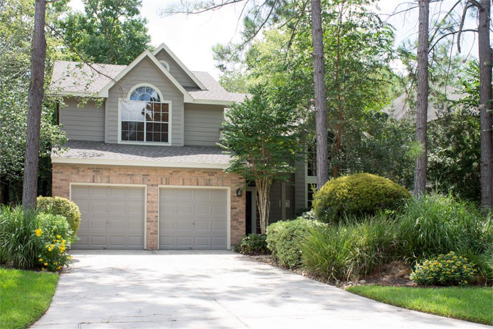 This wonderful central Woodlands location is within walking distance of the Panther Creek and the Cochrans Crossing Shopping Centers, plus David Elementary. Beautiful kitchen with granite countertops, wood floors, and updated stainless steel appliances. KITCHEN REFRIGERATOR, WASHER & DRYER INCLUDED! High ceilings in the den with lots of windows and natural light. Lots of patio space in the back yard and LAWN MAINTENANCE INCLUDED!!