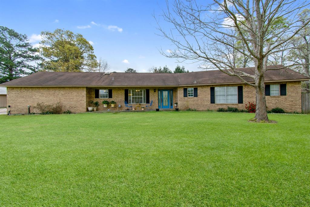 ACREAGE with ATTRACTIVE Ranch Style Home. This brick house on a slab offers 2,260 square feet, 3 bedrooms, 3 baths - on 26.77 acres with pond. Fenced - Cross Fenced - Pastures. Long driveway leads you to the home. Huge Living Room with Gas Fireplace. Breakfast Area with Serving Bar and Formal Dining Area. Large bedrooms. Full Hallway Bath - offers Tub with Shower. Bathroom 3 situated next to Oversize Utility Room by the Back Entrance. 2-Car Attached Garage - Converted-could be 4th Bedroom, Study/Office, Man Cave, or Game Room. New Water Heater, New HVAC/Heat inside and outside. New Stove/Oven. Property also offers a 41x20 Office attached to Carport. 30X50 Steel Built Shop/Barn with Loft/Storage. Rural Area with opportunity to raise Farm Animals and plenty of land for Gardening. UNRESTRICTED! Leisure Ranch or just Escape to the County!  Call today!