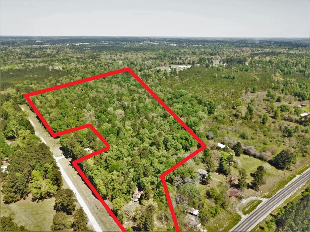 Great piece of land with easy access to the Houston area..  This tract of land is just a few miles from Lake Livingston and just a few miles from town.  Many hardwood trees throughout the tract.  This tract could have many possibilities. Come check it out today.
