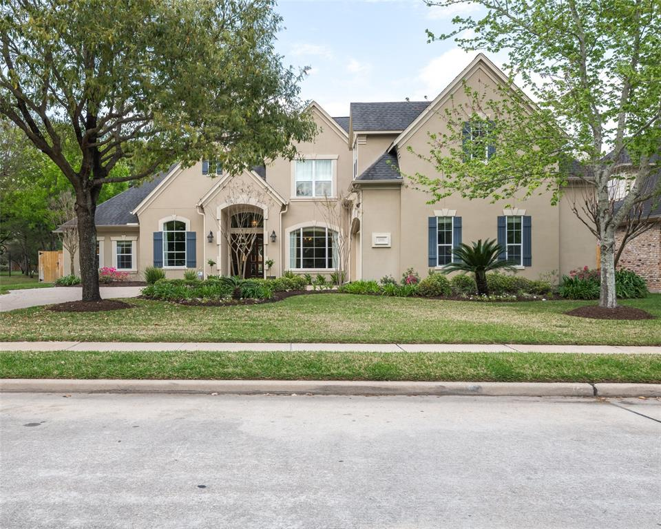 Stunning, original owner/custom built 2 story, 4 bedroom, 4.5 bath home in coveted gated Bayou Oaks Subdivision - Cinco Ranch! Beautiful study with wood built-ins and french doors as well as a formal dining room with wood floors! Formal living room features a fireplace and french doors with pool views. You'll love the family room with a wood burning fireplace, built-ins and plenty of natural light as well as wood floors! The bright and airy kitchen has a breakfast bar, granite counters, double ovens, and an extensive island with seating. Don't miss the crown moulding in the master bedroom as well as the en-suite with dual sinks and extra-large shower! All bedrooms have en-suite baths. Home also features 2 game rooms, safe built into floor and Tech shield in the roof! Step into your backyard oasis with an in-ground pool and spa, covered patio with fans, outdoor kitchen, and expansive deck area! Located next to the greenbelt with easy access to TX-99! HOME DID NOT FLOOD DURING HARVEY