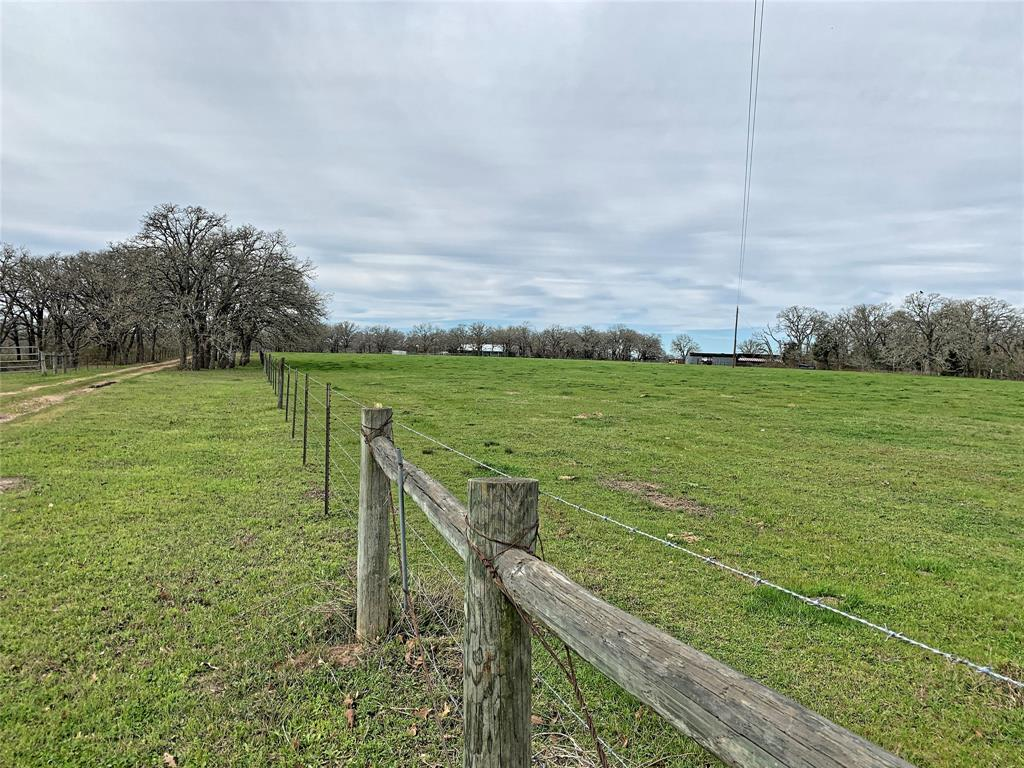 Located 9.8 miles northeast of Giddings, Texas and just over 1 hour from Austin, Texas, the 89 acre Sweet Oaks Ranch offers quintessential central Texas topography, open grazing and oak covered pastures. Surrounded by larger neighboring ranch tracts, Sweet Oaks Ranch provides isolation and privacy. Two ponds, ranging in size from .2 acres to .5 acres, in addition to a well; ensure an ample supply of water for the ranch amenities, fields, and livestock. The cross fencing enables grazing rotation among 5 separate pastures throughout the ranch to minimize overgrazing of the native and improved pasture. Approximately 28.5 acres are improved pasture with the remaining land being a mix of native grasses, mesquite brush, post oak, and timber. Sweet Oaks Ranch offers a diverse landscape with an ideal balance for deer hunting and cattle grazing. The ranch also features 2 homes, 1 modular office building, and a good set of cattle pens.