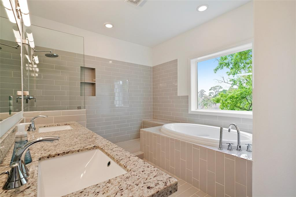 The master bathroom offers double sinks with granite counter-tops, a spacious garden tub, and large separate shower.