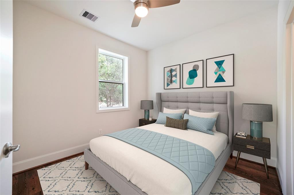 This downstairs bedroom has beautiful wood floors and it's own en suite bathroom. *furniture is virtually staged*