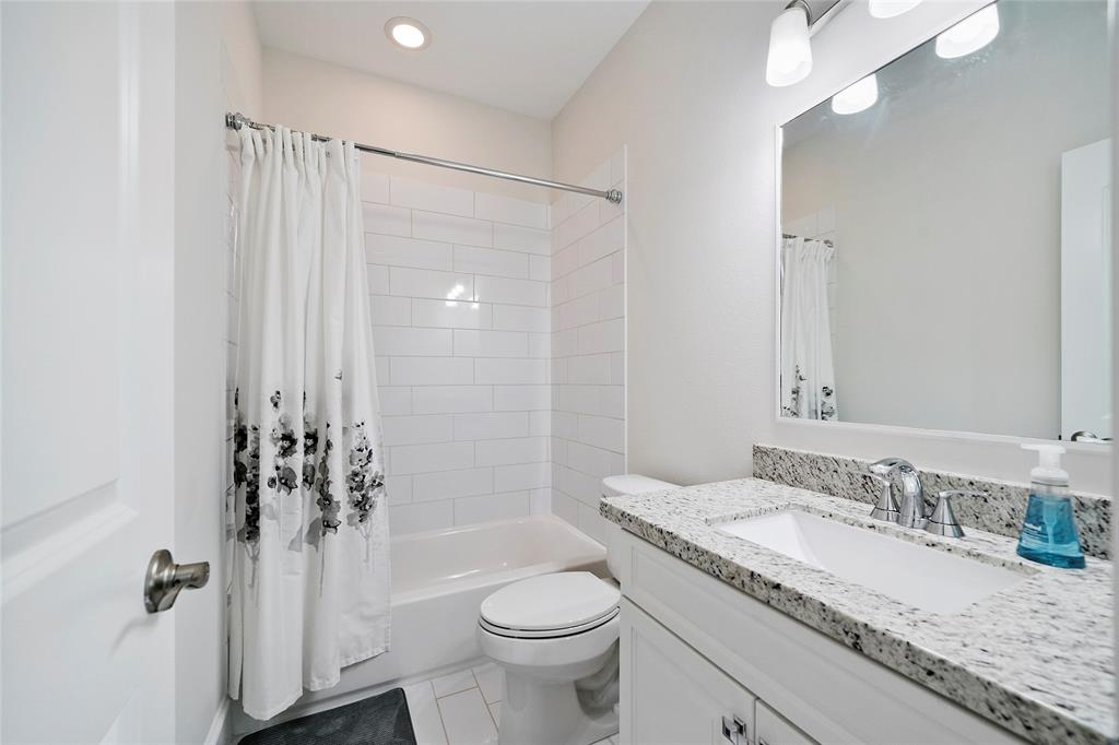 The bathroom en suite is located just off the 3rd floor bedroom and includes subway tile surround and granite counter-tops.