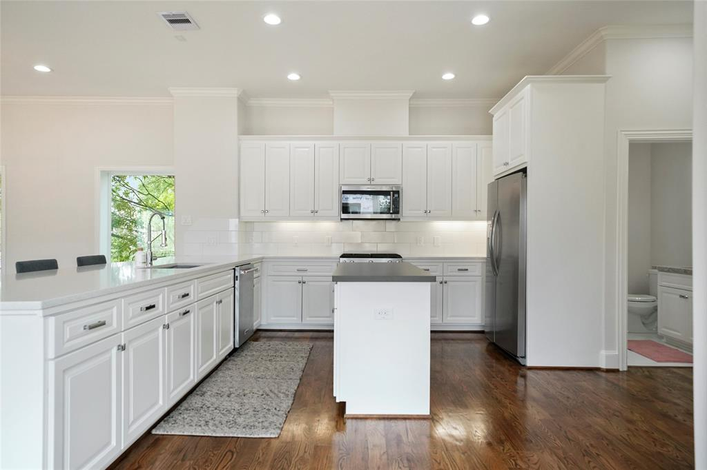 There is so much beautiful cabinet space here; notice the under cabinet lighting!