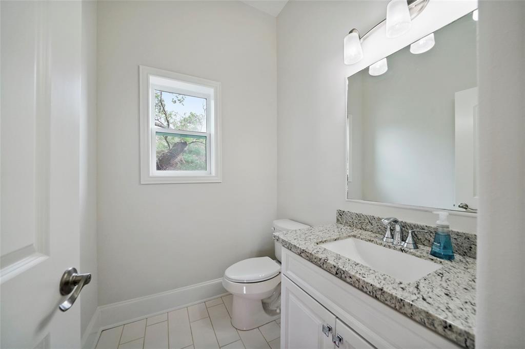 The half-bath is located just off the kitchen on the main floor.