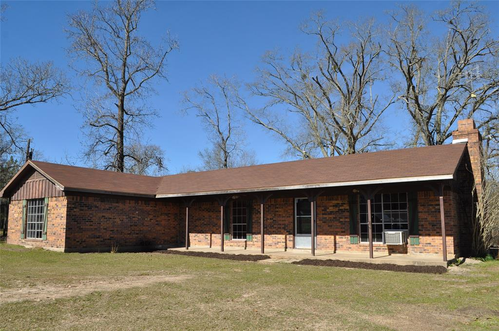 Secluded ranch style home located on 12.415 acres in Crockett! Property includes metal building and barn. House features 3 bedrooms, 2.5 bath, and game room.