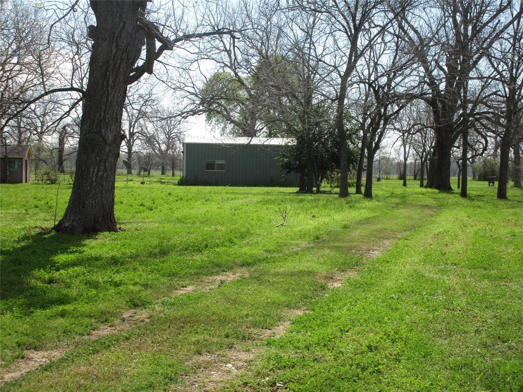 Wharton/Hungerford area. Close to Hwy 59. Nice 2.5 acres with beautiful pecan trees, pond. Barndominium (30X40) on concrete slab with studio apartment. Great place to build your new home.
