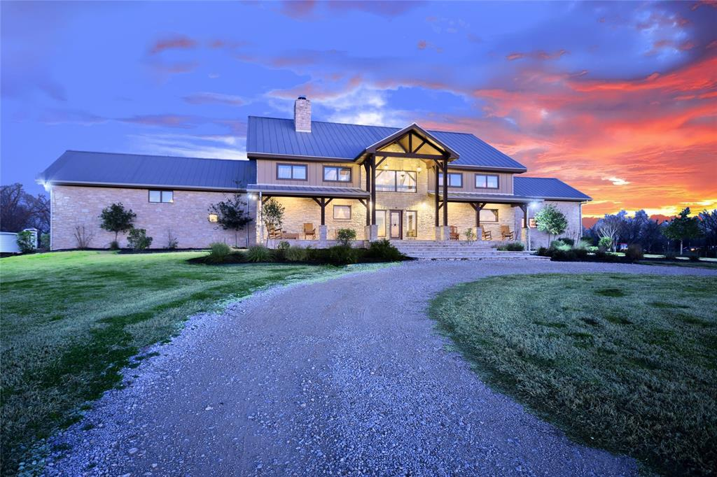 One of a kind Estate created from two 200-year old barns from upstate NY on almost 23 acres w/ pecan orchard & large beach entry into Colorado River. Limestone walls, wood floors, Wolf appliances, Subzero fridge/freezer, farmhouse sinks, 2 dishwashers, leathered granite w/ rubies, wine cellar, & outdoor kitchen. Smart tech controlled by an app: 4 programmable thermostats, door locks, lutron lighting, LED lighting, alarm, cell phone modem, insulated garage doors w/ openers, & front gate. Garage contains central vac, charging station & entry to basement housing all mechanicals. Rain H2O collection system provides H2O for the home, well backup, 3 Geothermal HVAC units, 3 Desuperheaters for hot H2O, air filtration, 2 ERV units,  polystyrene panels, double pane, low E windows, hay pasture, approx 477 feet of river frontage, stocked pond, well house w/ tractor parking, bathroom and storage. Take the 3D tour for more info/detail.