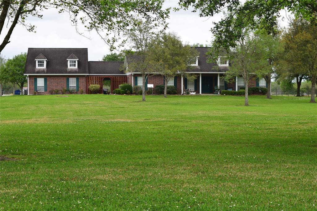 Beautiful home (NO FLOODING)  sitting on ~17 (ag exempt) acres with Equipment shed (40' x 60'), and 2  stocked ponds. Property has it all,  massive rear patio with view of the  .6 acre pond. Home is 4/3 1/2  with detached double garage and additional carport, guest suite with full bath and  private entrance. Room sizes are approximate. Buyer to confirm room sizes. The home is shaded by 50+ beautiful Oak and Cypress trees. A wonderful homestead for great country living or weekend retreat; truly a must see.