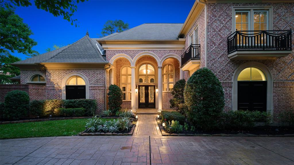A masterpiece of timeless elegance by Sterling Classic Homes. Nestled amongst the trees on an exceptional lot in Carlton Woods, this home's stately exterior and luscious private backyard dazzle with an inviting and classy pool underneath the Texas sky. Soaring entry welcomes you to formal  2-story living & formal dining centered by a gorgeous wrought iron spiral staircase. Kitchen highlights Thermador appliances, dish warmer, 2 large islands, exposed beam ceiling & plenty of storage and space to entertain. 1st floor Master with sitting area & his and hers master closets and additional private guest bedroom down w/en-suite. Spacious 3 secondary bedrooms upstairs with en-suite bath, game room & media room. Elevator shaft, 2 staircases, plantation shutters, wood & travertine flooring and circular driveway complete this amazing property. Enjoy panoramic views of the beautiful grounds from every wing of this home & an amazing backyard with a resort-like feel.