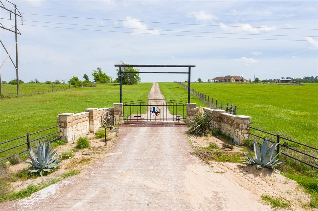 This gorgeous ranch offers all the amenities you're looking for! The property includes amazing sunrises & sunsets, easy access to Navasota, Anderson, College Station & 1 hour away from Houston, 96 acres of rolling meadows, 3.5 acre pond stocked w/bass & 2nd pond stocked w/catfish, all income producing coastal bermuda hay fields. 2 barns & an approximate 1200 sq ft metal shop on slab. Custom 1-story home w/wood-like tile floors & wood beams in the living room, dining & kitchen, large outdoor patio w/stone flooring, outdoor kitchen & fire pit, 2-car carport, 2 wells, 2 new A/C units & new water heater. The chef will love cooking in this gorgeous gourmet island kitchen w/tons of storage space in the cabinets, beautiful stone wall on the island & around the stove, granite counters, stainless steel appliances, butlers pantry & walk-in pantry. Game room w/built-in gun case & wet bar. Second house on the property. Large barn 8000 sq ft, 5400 sq ft barn & adjoining 2790 sq ft equipment shed.