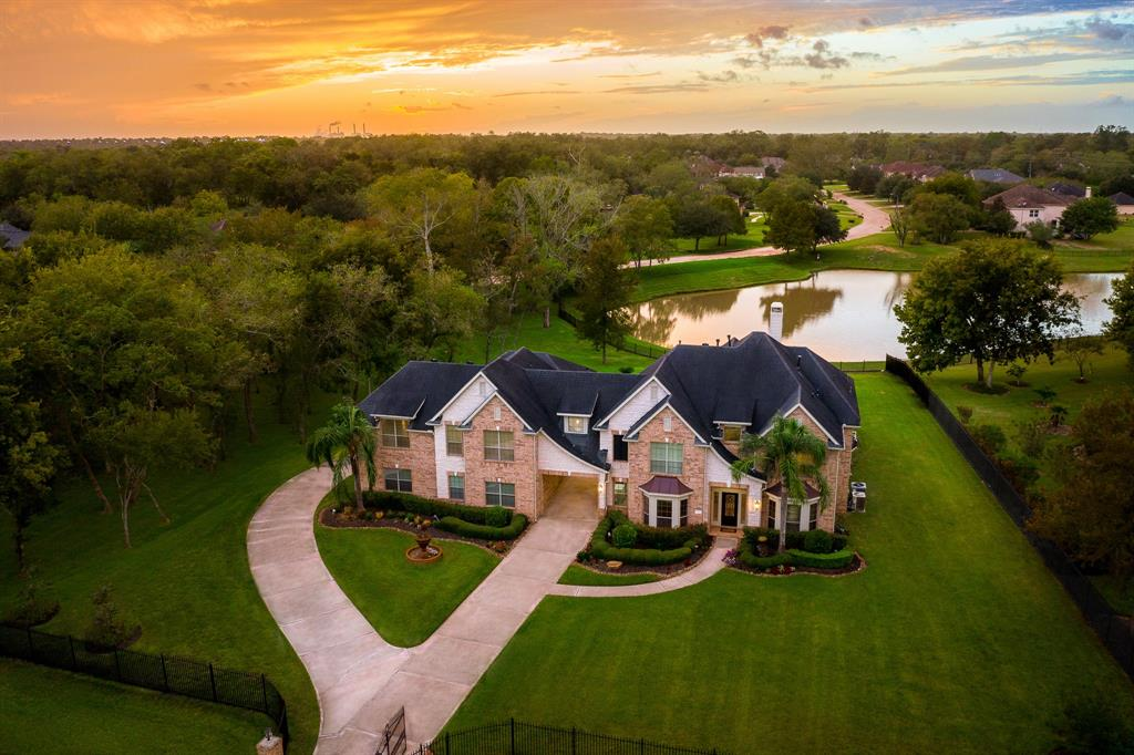 "NEWLY REDESIGNED! Positioned on a secluded, fully gated estate encompassing almost 2 acres of mature trees & impeccably landscaped grounds rests this luxurious retreat. Grandeur abounds in the master suite complete with private sitting area & gas log fireplace. The NEW en-suite bath presents marble floors and surround, seamless glass separate shower, and oversized soaking tub. An impressive study of discriminating style features rich wood paneling & custom built ins. Two dramatic stairways lead to secondary private bedrooms, all boasting sleek en-suite baths, generous closets, & breathtaking views. The upper level includes media room, secret room, built in study area, & large play room or second private living area w/second master suite. Sprawling entertainment spaces flow outside to the open air terrace featuring a ""grand"" sized heated saltwater pool & elevated circular spa and outdoor 1/2 bath. Highlights include FRESH PAINT, NEW CARPET, NEW WOOD FLOORING. LOWEST TAX RATE in Sienna!"