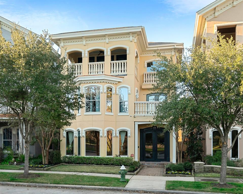 EXTRA SPECIAL beautifully appointed custom in sought after East Shore! Great views of the lake & park enjoyed on either of 2 balconies! Features include designer decor & lighting, Belgium blue slate & real wood flooring throughout, high ceilings, tons of lights, 42 speaker audio system, security cameras, Viking Professional range, built-in Thermador Professional fridge, wine fridge, hidden pantry, huge island in kitchen, 2 fire places, large oak doors, hand crafted windows, tailored iron railing, steam shower, 2 utility rooms & more! View of the lake/park from the study nook off of the 3rd floor game room! Over-sized 3 car garage w/ mother in law/private guest suite apartment above complete w/ wood floors, custom cabinets & granite counters! Large tiled patio w/ plenty of room for a summer kitchen or even a small pool! Close to the East Shore Clubhouse which has pool/gym/kitchen/party room/etc. Walk to Hughes Landing, Market Street, Pavilion, super easy access to 45 and a low tax rate!