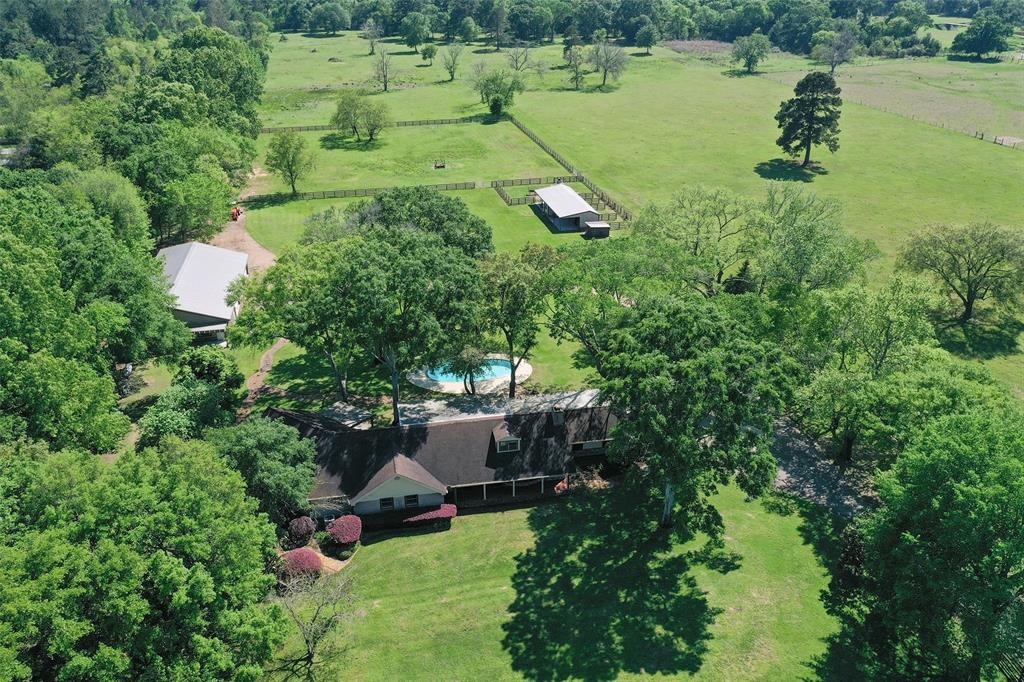 Fabulous country property minutes from grand parkway 99 and 290. This property has about 25 acres and features a private swimming pool, stables, fenced and cross fenced. Garage guest house, huge work shop and the list goes on!. Country property but close to all amenities. Peace and quiet of the country life yet minutes from everything! Bring your horses!!!.